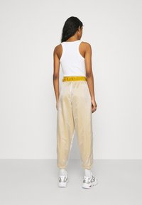 Nike Sportswear - PANT - Tracksuit bottoms - dark citron/white/black - 2