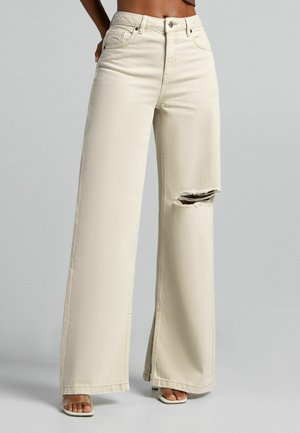 Flared jeans - sand
