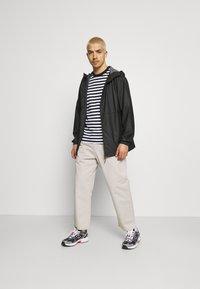 Rains - ULTRALIGHT JACKET UNISEX - Waterproof jacket - black - 1
