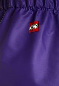 LEGO Wear - PATIENCE - Kalhoty do deště - dark purple - 2