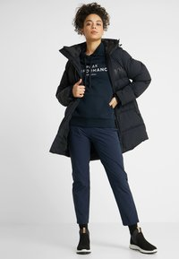 Helly Hansen - ADORE PUFFY - Winter coat - black - 1