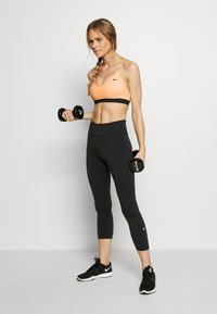 Nike Performance - INDY BRA - Sports bra - washed coral/black/black - 1