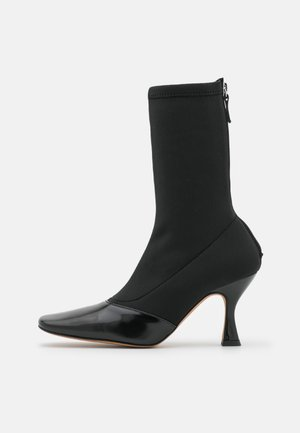LINDA - Classic ankle boots - black