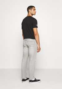 G-Star - ALUM RELAXED TAPERED - Relaxed fit jeans - sato black denim/sun faded ripped pewter grey - 2