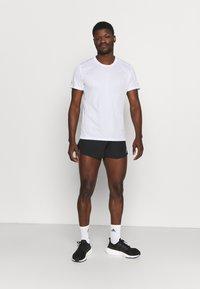 adidas Performance - FAST SPLIT - Sports shorts - black - 1