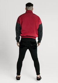 SIKSILK - WINDRUNNER - Giacca leggera - red/black - 2