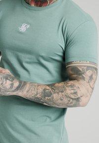 SIKSILK - Basic T-shirt - light petrol blue - 4