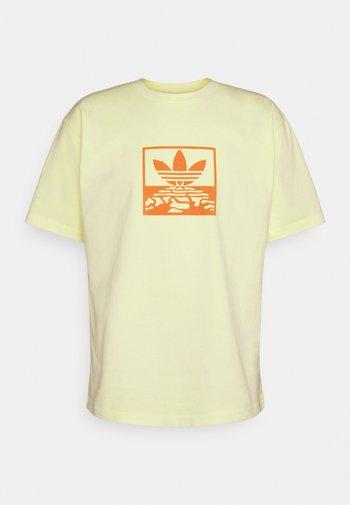 OVERDYE TEE UNISEX - T-shirts print - ice yellow