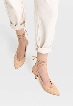 Lace-up heels - beige