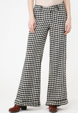 Trousers - weiß schwarz
