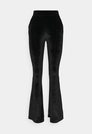 SIYAH - Trousers - black
