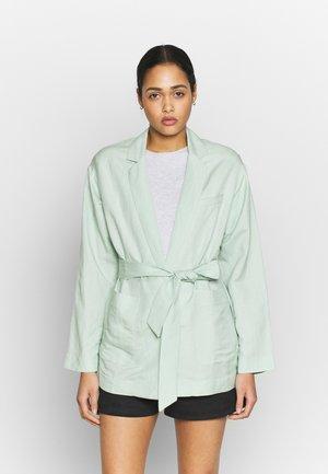 INSKA - Short coat - cameo green