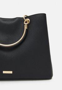 ALDO - SURGOINE - Handbag - black - 3