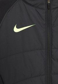 Nike Performance - STRIKE WINTERIZED - Training jacket - black/volt - 2