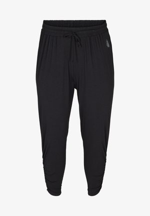 FITNESS - Tracksuit bottoms - black