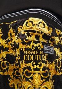 Versace Jeans Couture - TECNO  PRINT LOGO BAROQU  - Tracksuit bottoms - black - 5