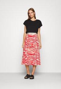 Calvin Klein - ZEBRA PRINT LOGO SKIRT - A-line skirt - red - 1