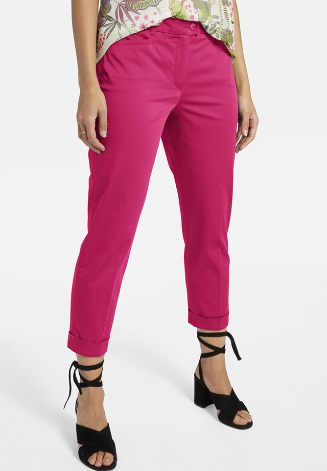 IM UNIFARBIGEN DESIGN - Trousers - pink