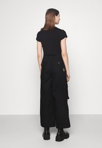 Karl Kani - RETRO BAGGY PANTS - Cargo trousers - black - 2