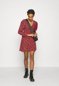 Topshop - V NECK SKATER DRESS - Day dress - red - 1