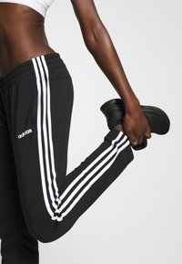adidas Performance - ESSENTIALS 3STRIPES OPEN HEM SPORT PANTS - Träningsbyxor - black/white - 3