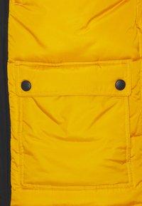 Fila - ESCURCIONE PUFFED JACKET - Winter jacket - nugget gold/black - 2