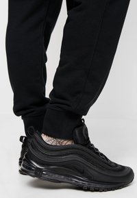 Nike Sportswear - CLUB - Trainingsbroek - black - 3