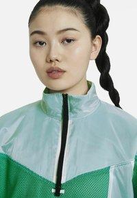 Nike Sportswear - W NSW TCH PCK - Windbreaker - neptune green/white/black - 2