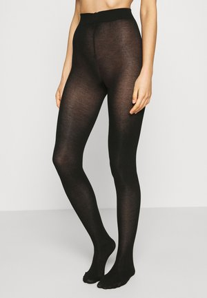 HEAVY ORGANIC - Tights - black