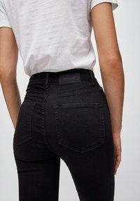 ARMEDANGELS - INGAA X STRETCH - Jeans Skinny Fit - black night - 4