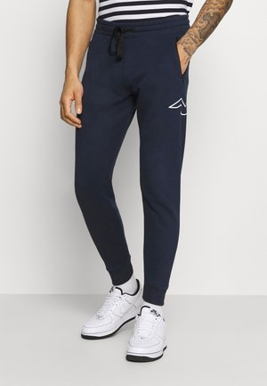ICONIC PRINT - Tracksuit bottoms - navy