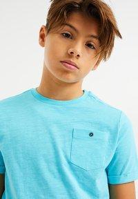 WE Fashion - WE FASHION JONGENS T-SHIRT - T-shirt basic - light blue - 1