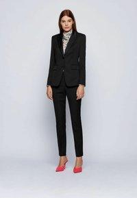 BOSS - TAXTINY - Trousers - black - 1