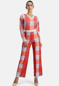Nicowa - Trousers - orange - 1