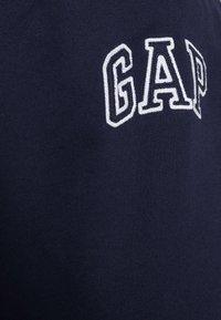 GAP - Spodnie treningowe - navy uniform - 4