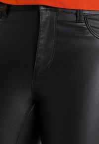 ONLY Carmakoma - CARPUNK SKINNY BIKER COATED  - Trousers - black - 3