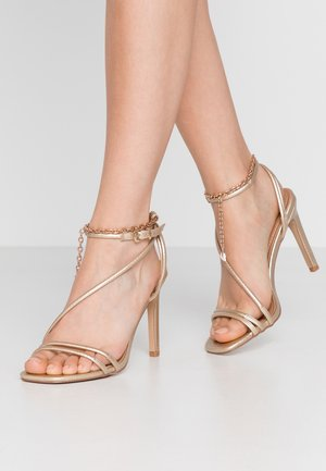 PATTI - Korolliset sandaalit - gold