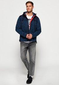Superdry - MOUNTAIN - Zip-up hoodie - indigo navy marl - 1