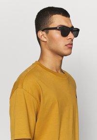 Lacoste - Sunglasses - matte black - 1