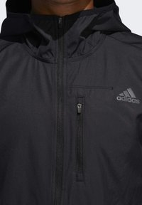 adidas Performance - OWN THE RUN HOODED WINDBREAKER - Training jacket - black - 5