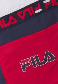 Fila - SOFT DRAWSTRING BACKPACK UNISEX - Sports bag - black iris/true red/bright white - 4
