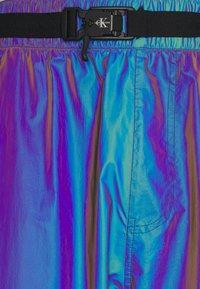Calvin Klein Jeans - FASHION IRIDESCENT PANT - Tracksuit bottoms - purple - 2