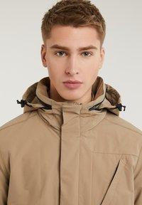CHASIN' - SATURN LIGHT - Short coat - beige - 9