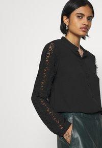 Vero Moda - VMZIGGA - Button-down blouse - black - 3