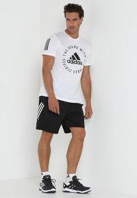 adidas Performance - 4KRFT TECH WOVEN SHORTS - Korte broeken - black/white - 1