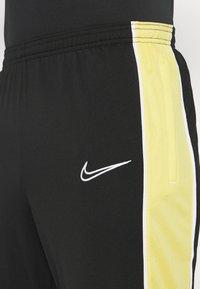 Nike Performance - ACADEMY PANT - Teplákové kalhoty - black/saturn gold/white - 4