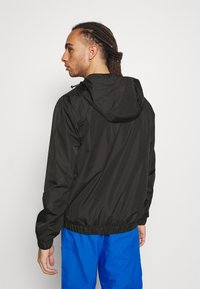 Champion - WINDBREAKER - Training jacket - black - 2