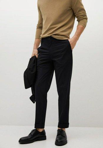 SLIM FIT - Trousers - schwarz