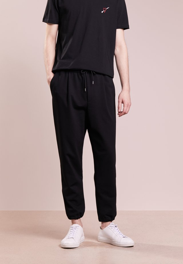 TAILORED TRACKPANT - Tracksuit bottoms - darkest black