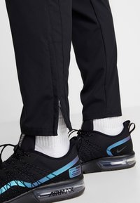 Nike Performance - RUN STRIPE PANT - Tracksuit bottoms - black/silver - 3